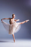 Young beautiful ballerina dancer dancing on a studio background Royalty Free Stock Image