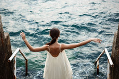 Young beautiful ballerina dancing and posing outside, sea background. Stock Image