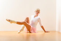 Young beautiful ballerina exercising in the studio Royalty Free Stock Image