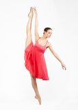 Young beautiful ballerina on a gray background Royalty Free Stock Photos
