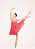 Young beautiful ballerina on a gray background Royalty Free Stock Photography