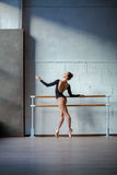 Young beautiful ballerina posing in studio Stock Photo