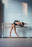 Young beautiful ballerina posing in studio Stock Photography