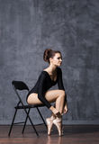 Young and beautiful ballerina sitting on a chair in a point shoes Royalty Free Stock Photos
