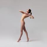 Young beautiful ballet dancer in beige swimsuit Stock Photo