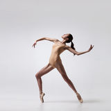 Young beautiful ballet dancer in beige swimsuit Stock Photo