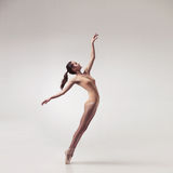 Young beautiful ballet dancer in beige swimsuit Stock Image