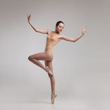Young beautiful ballet dancer in beige swimsuit Stock Photography