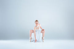 Young and beautiful ballet dancer. Contemporary modern dance. young and beautiful dancer in white dress is dancing on a light background in Studio Stock Photography