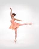 A young ballet dancer in an orange dress Royalty Free Stock Photos