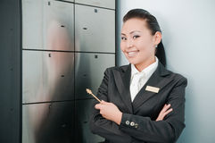 Young beautiful bank worker. Young beautiful asian bank worker at depository Royalty Free Stock Image