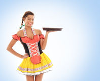 A young and beautiful bavarian girl holding a plate Stock Photos