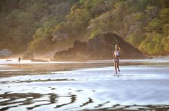 Young beautiful on a beach. One. Coast Pacific of ocean in Costa Rica Royalty Free Stock Photos