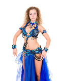 Young beautiful belly dancer in a blue costume Royalty Free Stock Photos
