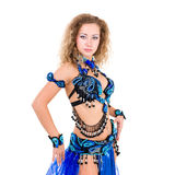 Young beautiful belly dancer in a blue costume Stock Photos
