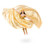 Young beautiful belly dancer in a gold costume Stock Photos