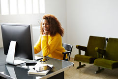 Young beautiful black girl works in home office Stock Photography