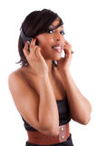Young beautiful black woman  listening to music Stock Photo