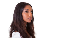 Young beautiful black woman looking up. Closeup portrait of a young beautiful black woman looking up Royalty Free Stock Photography