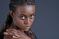 A young Beautiful black woman looks into your eyes Royalty Free Stock Photo
