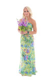 Young beautiful blond in dress with summer flowers isolated on w Royalty Free Stock Photography