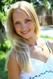 Young beautiful blond female with long hair Royalty Free Stock Image