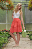 Young beautiful blond in the garden Stock Images