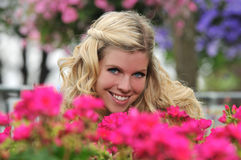 Young beautiful blond girl at the garden Stock Image