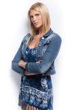 Young beautiful blond girl wearing blue jacket. Stock Photography
