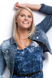 Young beautiful blond girl wearing blue jacket. Royalty Free Stock Images