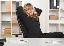 Young beautiful blond haired business woman Royalty Free Stock Images