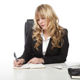 Young beautiful blond haired business woman Royalty Free Stock Photos
