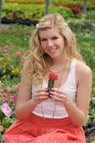 Young Beautiful Blond Holding A Cactus Royalty Free Stock Images
