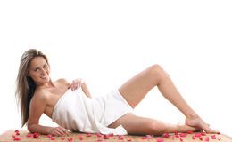 A young and beautiful blond is lying in a towel Royalty Free Stock Photography