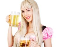 Oktoberfest woman with big breast Holds two mugs. Young beautiful blond oktoberfest woman with big neckline on female breast Holds two mugs with light beer Royalty Free Stock Image