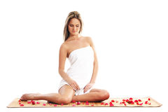 A young and beautiful blond is sitting in towel Stock Photography