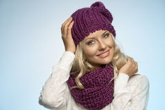 Young beautiful blond wearing scarf and winter hat Stock Photo