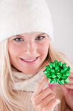 Young beautiful blond winter woman with gift Royalty Free Stock Photos