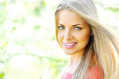 Young beautiful blond woman. Closeup of happy cheerful smiling young beautiful blond woman, outdoors stock photography