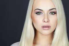 Young Beautiful blond woman.Beauty Girl.green cat eyes.make-up Royalty Free Stock Image