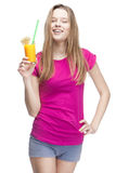 Young beautiful blond woman drinking orange juice Royalty Free Stock Photo
