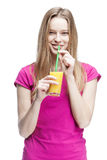 Young beautiful blond woman drinking orange juice Stock Photos