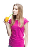 Young beautiful blond woman drinking orange juice Royalty Free Stock Photo