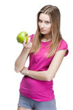 Young beautiful blond woman holding green apple Royalty Free Stock Images