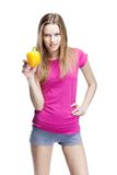 Young beautiful blond woman holding yellow papper Royalty Free Stock Image