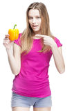 Young beautiful blond woman holding yellow papper Stock Photo