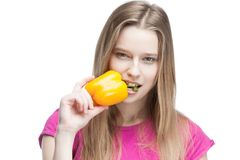 Young beautiful blond woman holding yellow papper Royalty Free Stock Photos