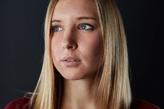 Young beautiful blond woman is looking to the side stock photography