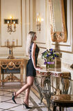 Young beautiful blond woman in luxury interior Stock Photos