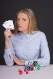 Young beautiful blond woman playing poker Stock Photo